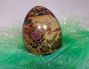 Porcelain egg with flowers and birds