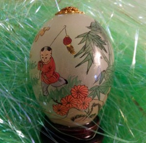 Glass egg with stand. The scene is children playing. It is painted from inside.